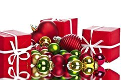 Christmas presents and christmas balls. Reflecting in water Royalty Free Stock Images