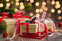 Christmas presents. And festive decor over wooden background royalty free stock photo