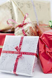 Christmas Presents Close Up. A studio Isolation of some cristmas presents wrapped up. The gifts have been shot with a shallow depth of field. They have ribbons Royalty Free Stock Photo