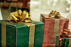 Christmas presents. Close up of green and red christmas presents with bows Royalty Free Stock Photos