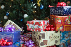 Christmas presents. Colorful Christmas presents near Christmas tree Royalty Free Stock Images