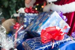 Christmas presents. Colorful Christmas presents near Christmas tree stock photo