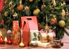 Christmas presents concept. Christmas tree and presents closeup royalty free stock photo
