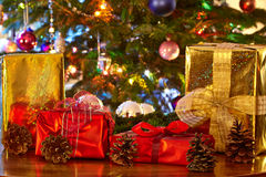 Christmas presents and cones, Christmas tree Stock Photography