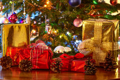 Christmas presents and cones, Christmas tree Royalty Free Stock Photo