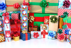 Christmas Presents with copyspace. Close up of a large stack of wrapped Christmas presents of varying sizes and shapes with copyspace in the foreground royalty free stock photos