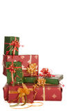 Christmas presents corner. Isolated stack of christmas presents in red and green Stock Images