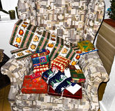 Christmas presents are decorated on a chair Stock Photography