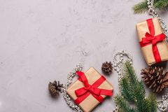 Christmas presents decorated with red ribbon on grey stone background Stock Photo