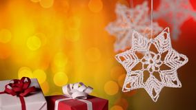Christmas presents and decorations against warm blurry lights background stock video footage