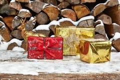 Christmas presents and deer figurine Stock Photos