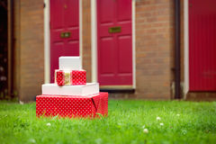 Christmas presents delivered to house front door in summer. Christmas gift boxes delivered to house front door in summer. Early Christmas preparation concept Royalty Free Stock Photos