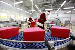 In the Christmas presents factory royalty free stock image