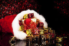 Christmas presents falling from santa's hat Royalty Free Stock Photography