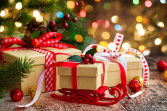 Christmas presents. And festive decor over wooden background Stock Image