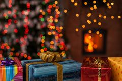Christmas presents in front of xmas tree and fireplace. Various colorful christmas presents in front of xmas tree and fireplace royalty free stock photography