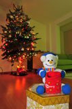 Christmas, presents and Frosty the snowman. Frosty the snowman toy and a Christmas tree royalty free stock photo