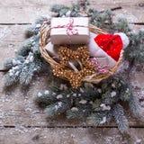 Christmas presents, fur tree and decorative star and Santa hat o Stock Photo