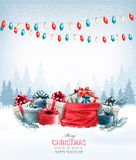 Christmas presents with a garland and a sack full of gift boxes. Royalty Free Stock Photography