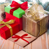 Christmas presents. Gift boxes with ribbons. Stock Photos