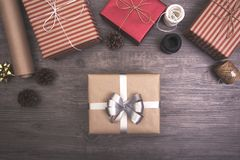 Christmas presents gift red and rustic decorated laid on wooden table background Stock Image