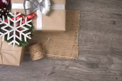 Christmas presents gift red and rustic decorated laid on wooden table background Stock Photo
