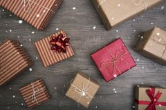 Christmas presents gift red and rustic decorated laid on wooden table background Royalty Free Stock Image