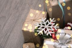 Christmas presents gift red and rustic decorated laid on wooden table background Royalty Free Stock Photo