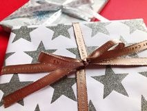 Beautifully wrapped Christmas gifts on a plain background stock images