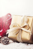 Christmas presents or gifts with elegant bow and christmas decorations on bright snowy background Stock Photo