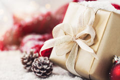 Christmas presents or gifts with elegant bow and christmas decorations on bright snowy background Stock Photography