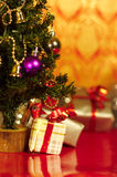 Christmas presents or gifts under tree vertical Stock Photos