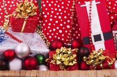 Christmas Presents Hamper. A selection of wrapped Christmas gifts and decorations, some of the gifts are hand crafted in a hamper stock images
