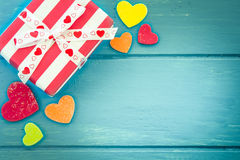 Christmas presents with heart on blue wooden table royalty free stock image