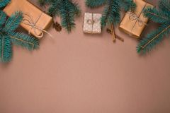Christmas presents in kraft paper with pinetree branches stock image