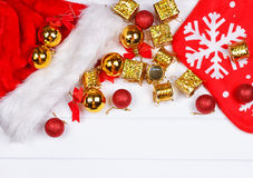 Christmas presents laid on a wooden table background Royalty Free Stock Photos