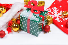 Christmas presents laid on a wooden table background Royalty Free Stock Images