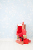 Christmas presents. Many red Christmas presents stacked at the floor Royalty Free Stock Images
