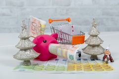 Christmas presents, money with pink piggy bank Royalty Free Stock Photography