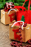 Christmas presents next to festive fir tree Stock Photos