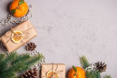 Christmas presents and oranges on grey stone background Stock Photo