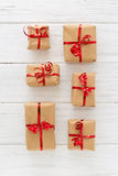 Christmas presents organized on a wooden background royalty free stock images