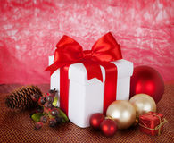 Christmas Presents and Ornaments on red Background Royalty Free Stock Photography