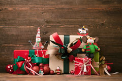 Christmas Presents. And Ornaments on Wooden Background Royalty Free Stock Image