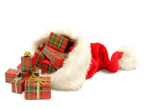 Christmas presents out of santa claus hat Royalty Free Stock Photos