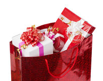 The christmas presents in the package. The christmas presents in the red package royalty free stock image