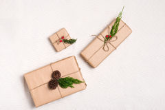 Christmas presents. Packages wrapped in kraft paper tied with ju. Te Stock Photos