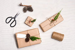 Christmas presents. Packages wrapped in kraft paper tied with ju. Te and  label to copy space Stock Images