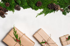 Christmas presents. Packages wrapped in kraft paper tied with jute Royalty Free Stock Photography