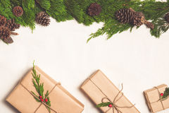 Christmas presents. Packages wrapped in kraft paper tied with jute.  Stock Photo